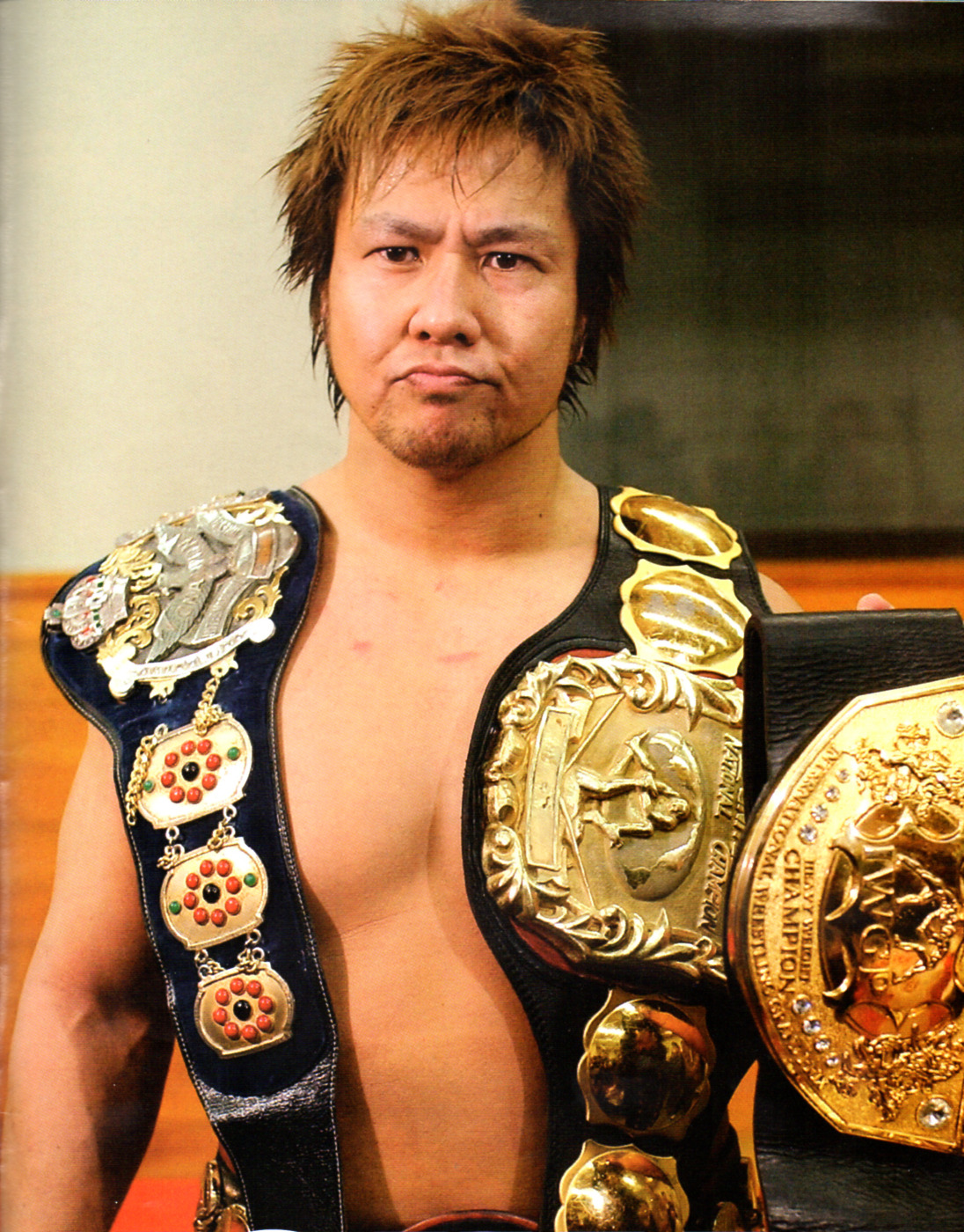Satoshi Kojima with his multiple world titles.
