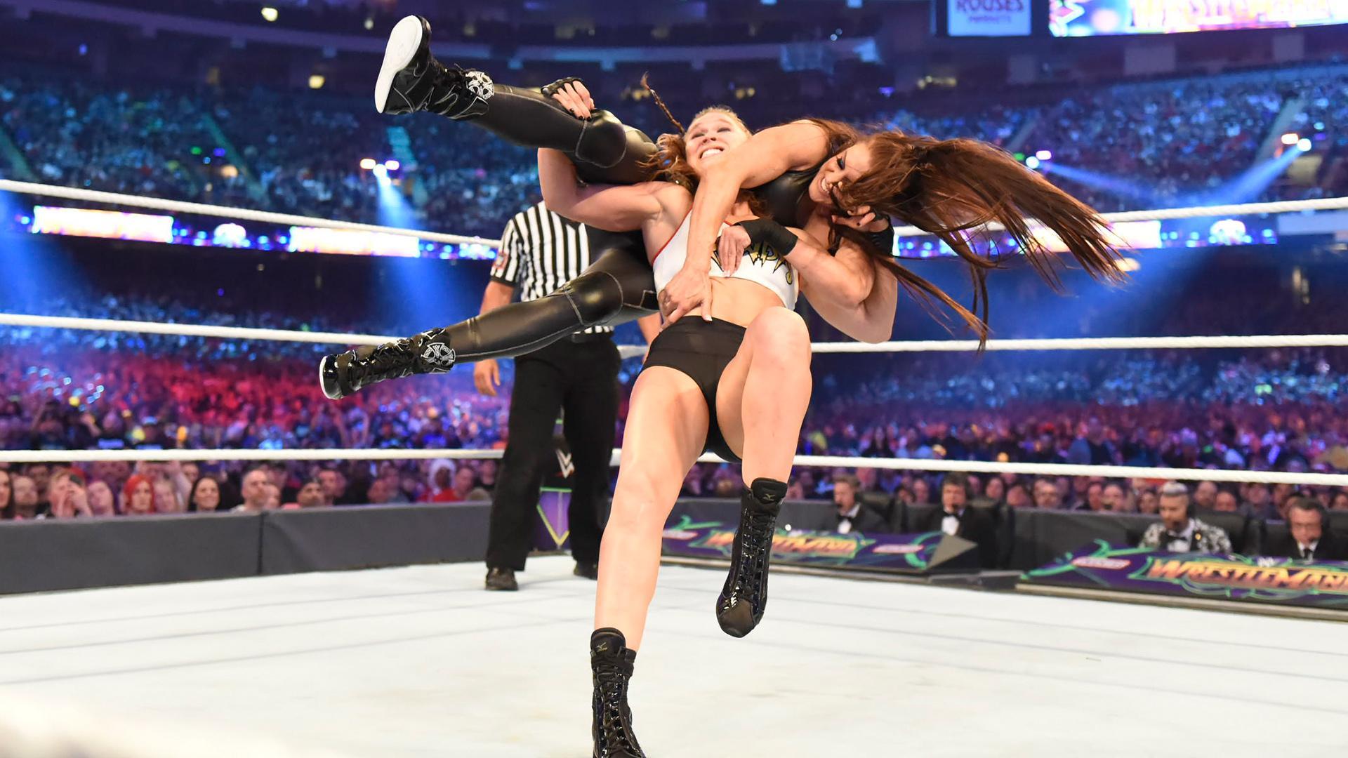 Ronda Rousey Kurt Angle vs Triple H Stephanie McMahon